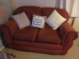 Two x 2 seater sofas - terracotta/; well looked after with fair wear and tear for their age.