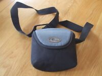 Lowepro camera bag in good condition with shoulder strap and shower proof cover.
