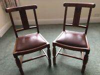 Two wooden dining chairs