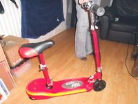 Childs Electric Scooter with seat.