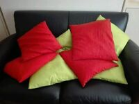 Cushions in orange and green total 8