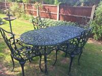 Large oval table and four chairs