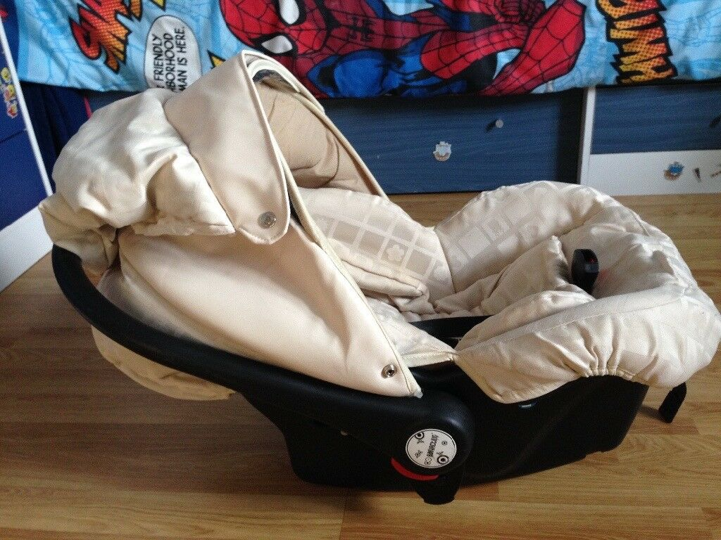 Used babyactive car seat suitable from birth,cream colour