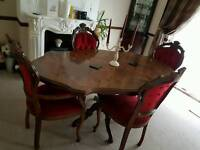 Rich dark wood dinning table & chairs