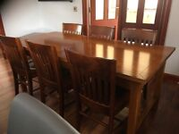 Dining table, 6 chairs, sideboard, side table.