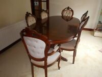 italian large oval dining table.4 chairs plus 2 carvers.