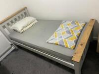 Single bed frame with mattress. Used but not for long and in perfect shape