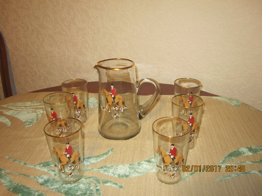 A glass jug and six glasses, in excellent condition, from smoke and pet free home, £6