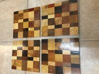 Set of 4 wood veneer mats for sale.