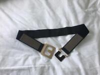 Stylish designer look gold clasp belt
