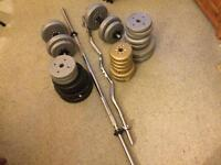 95 kg vinyl weights , with two long bars and two short bars.