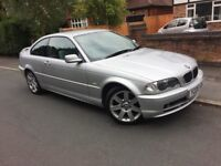Bmw 318i coupe nice looker drives well