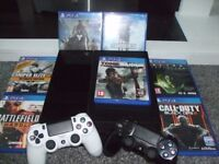 PlayStation 4 with 2 controllers and 7 games