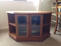 Wooden TV stand on wheels for sale.