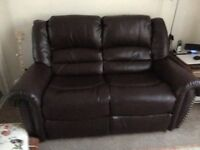 Two seater leather recliner settee