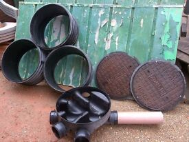 man hole base,3 risers and 2 iron covers (plastic frames broken)