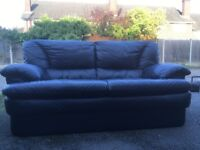Leather Sofa set £50. Three and Two seater available now - navy. Must be collected.