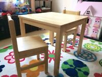 Wooden children's table and two chairs