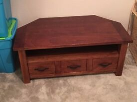 Solid dark wood corner TV cabinet and matching nest of two tables.