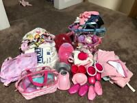 Large selection of dolls clothes and accessories
