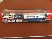 New, boxed diecast air streamer glider and trailer.