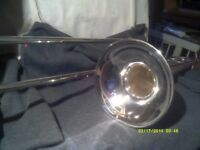 A TROMBONE In SILVER PLATE , IN V.G.C. SLIDES & PLATING all GOOD . only £ 95 .+++++
