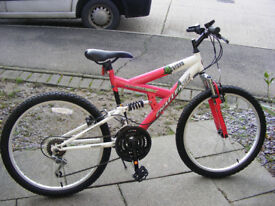"""GIRLS 24"""" WHEEL SUSPENSION BIKE HARDLY USED GREAT CONDITION AGE 10+"""