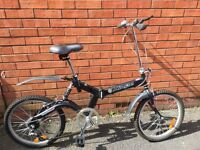 TWO FOLDING CYCLES. Used but in good condition, Both adult size . See photos.