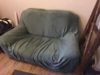 Leather sofa + cyan slipcover