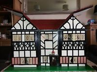 tudor style dolls house, lots of furniture, dolls and accessories, working lights
