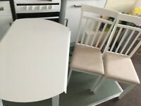 White wood coach table and 2 chairs
