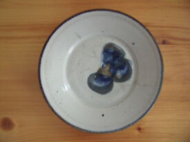 Attractive studio pottery plate or dish with blue abstract design. Excellent condition.