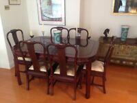 Solid rosewood table and 8 chairs. Extendable table lengths - 150 cms, 200 cms and 250 cms