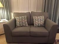 Pair of 2 seater grey sofas less than 6 months old.