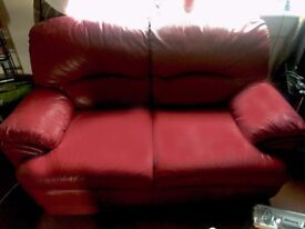 2 SEATER RED LEATHER SOFA (NEVER USED)