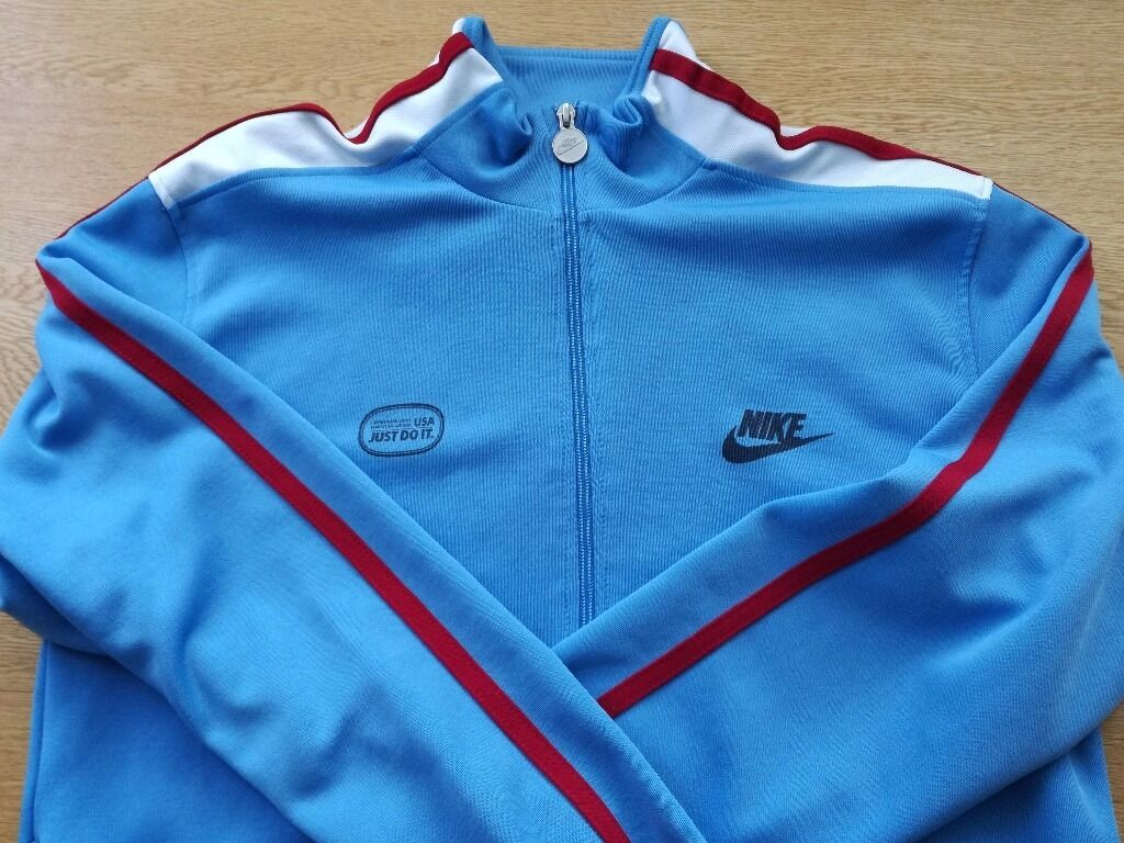 Nike track jacket Sky Blue with claret with white stripsMediumAs newin Coventry, West MidlandsGumtree - As new Sky blue with claret with white strips on shoulders and down arms Round metal tag with Nike logo on zipper Impulse buy @ £50 from Nike store, London Bargain at £15 No offers thank you