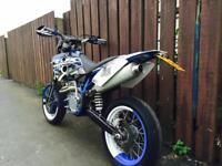 Husaberg 650 supermoto race bike on road not kx Cr yz rm of road motocross may swap focus st