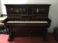 Lovely Victorian mahogany upright piano with candle holders