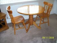 GOLDEN PINE TABLE AND TWO CHAIRS