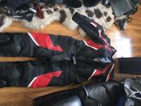 Ladies red and black bike leathers