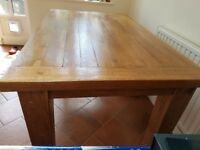 Solid reclaimed oak dining table