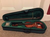 New Roling's 2/4 size wood violin with bow, bridge and hard case included.