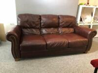 Splendid vintage chesterfield ranch antique brown leather club sofa.
