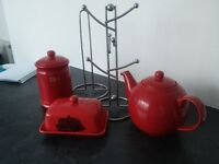 Red kitchen collection. Teapot, butter dish, tea caddy, mug tree and kitchen roll holder.
