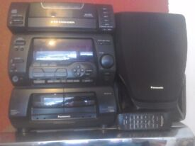 A panosonic auto system 5cd changer with remote tidy