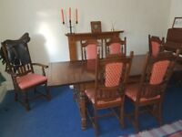 Solid, striking dining table with six matching chairs
