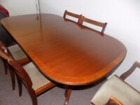 extending dining table plus four chairs and two carvers