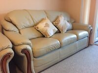 Leather three seat sofa and two arm chairs.