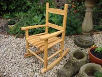 Solid Timber Child's Rocking Chair.