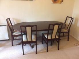 Debenhams mahogany foldable dining table with 4 chairs.